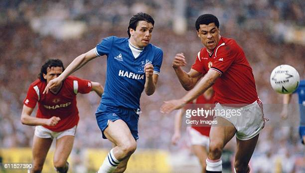 Manchester United defender Paul McGrath and Everton striker Graeme Sharp challenge for a loose ball during the 1985 FA Cup Final between Manchester...