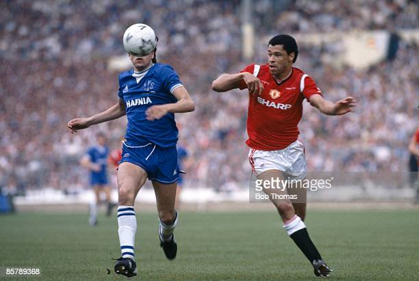 Manchester United defender Paul McGrath and Everton striker Graeme Sharp chase the ball during the FA Cup Final at Wembley Stadium 18th May 1985...