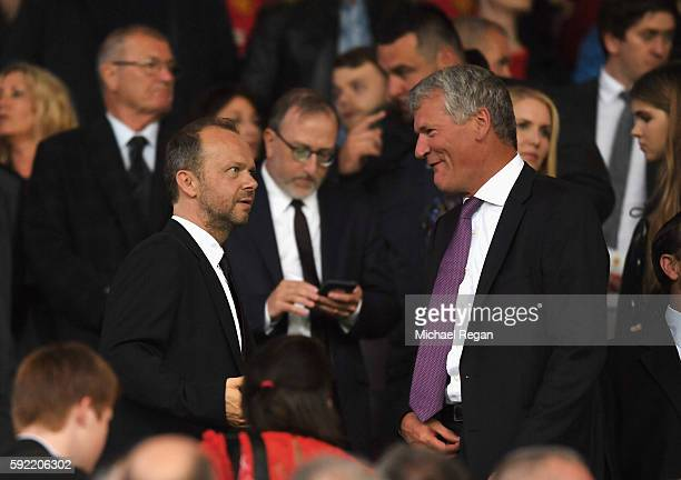 Manchester United Executive ViceChairman Ed Woodward talks with former Chief Executive David Gill during the Premier League match between Manchester...