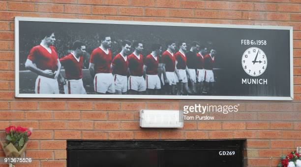 Manchester United fan attend a service commemorating the 60th Anniversary of the Munich Air Disaster ahead of the Premier League match between...