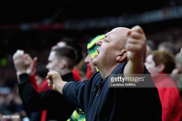 Manchester United fan celebrates during the Premier League match between Manchester United and Crystal Palace at Old Trafford on September 30 2017 in...