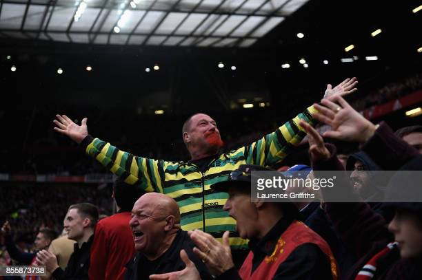 Manchester United fan celebrates his sides first goal during the Premier League match between Manchester United and Crystal Palace at Old Trafford on...