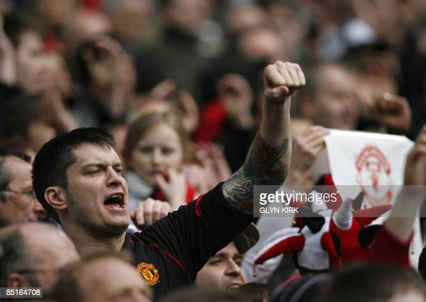 A Manchester United fan cheers for his team as they play against Tottenham during the 2009 Carling Cup final at Wembley stadium in north London on...