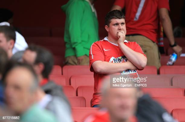A Manchester United fan dejected in the stands after defeat
