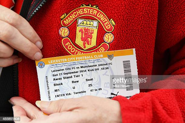 Manchester United fan displays his match ticket prior to kickoff during the Barclays Premier League match between Leicester City and Manchester...