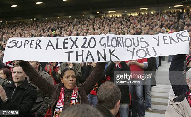 Manchester United fan holds a banner thanking Sir Alex Ferguson ahead of his 20th anniversary in charge at United during the Barclays Premiership...