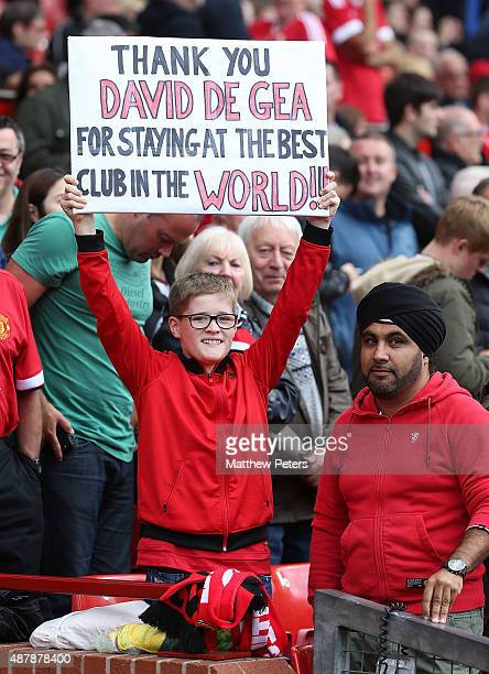 Manchester United fan holds up a sign thanking David de Gea for staying at the club during the Barclays Premier League match between Manchester...