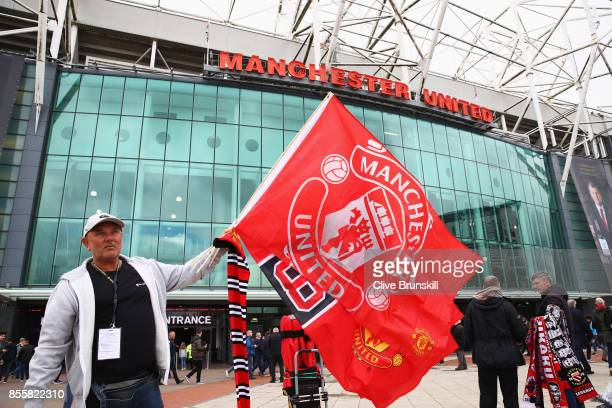Manchester United fan is seen outside the stadium prior to the Premier League match between Manchester United and Crystal Palace at Old Trafford on...