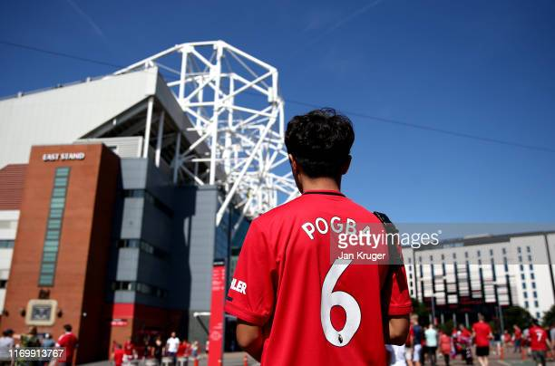 Manchester United fan looks at the ground prior to the Premier League match between Manchester United and Crystal Palace at Old Trafford on August 24...