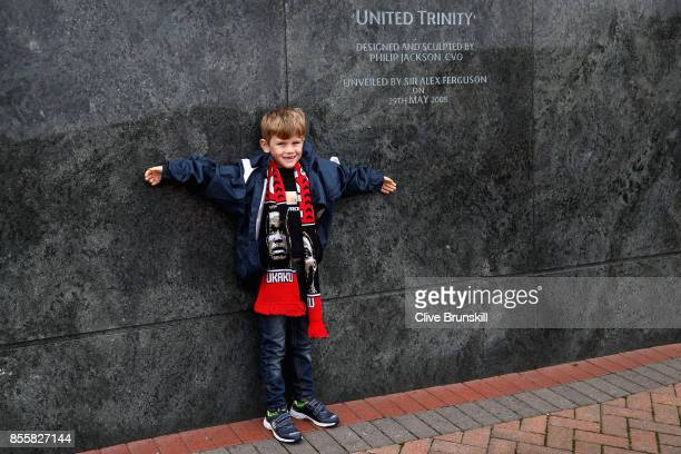 Manchester United fan poses for a photo prior to the Premier League match between Manchester United and Crystal Palace at Old Trafford on September...