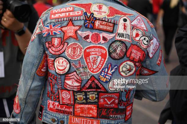 Manchester United fan shows off his badge coat pior to the Premier League match between Manchester United and Leicester City at Old Trafford on...