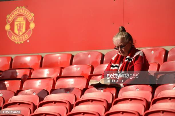 A Manchester United fan waits for kick off of the English Premier League football match between Manchester United and Liverpool at Old Trafford in...