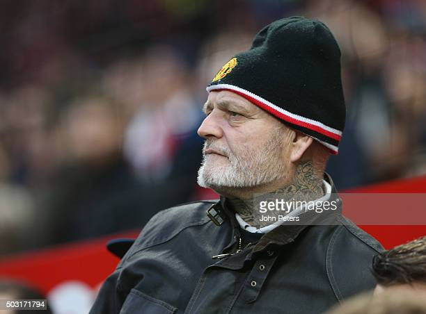 Manchester United fan watches from the stand during the Barclays Premier League match between Manchester United and Swansea City at Old Trafford on...