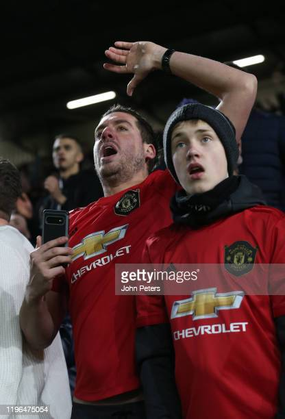 Manchester United fan watches from the stand during the Premier League match between Burnley FC and Manchester United at Turf Moor on December 28...