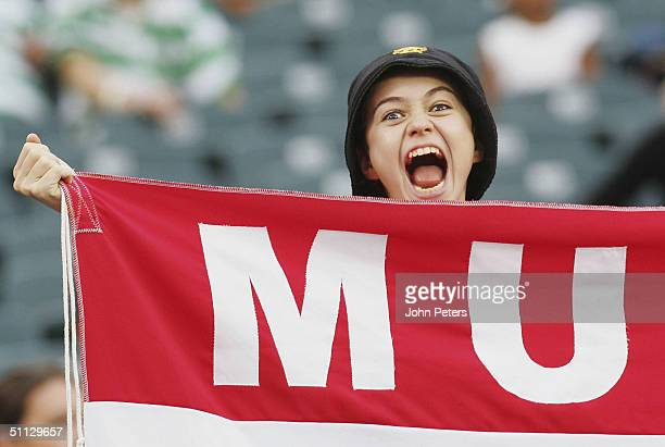 Manchester United fan watches the Champions World Series pre-season friendly match against Celtic, at Lincoln Financial Field,on July 29 2004 in...