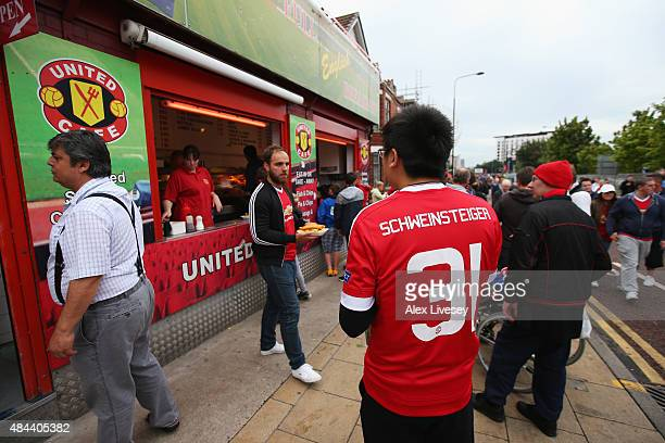 Manchester United fan wears the number 31 shirt worn by Bastian Schweinsteiger of Manchester United prior to the UEFA Champions League Qualifying...