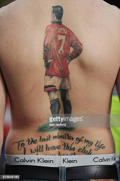 A Manchester United fan with a tattoo of former United hero Eric Cantona on his back before the 2011 UEFA Champions League Final between Barcelona...