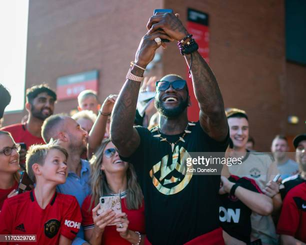Manchester United fans arrive ahead of the Premier League match between Manchester United and Crystal Palace at Old Trafford on August 24 2019 in...