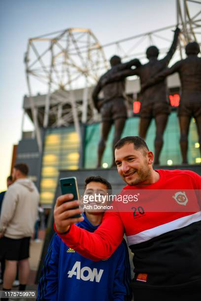 Manchester United fans arrive at Old Trafford ahead of the UEFA Europa League group L match between Manchester United and FK Astana at Old Trafford...