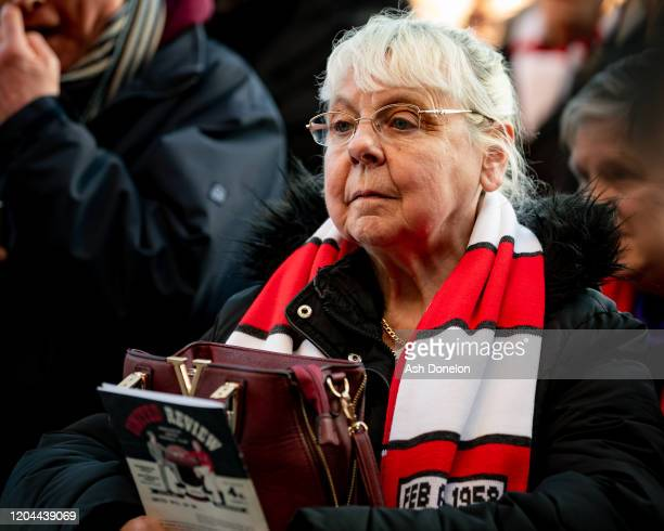 Manchester United fans attend a ceremony to mark the 62nd anniversary of the Munich Air Disaster at Old Trafford on February 06 2020 in Manchester...