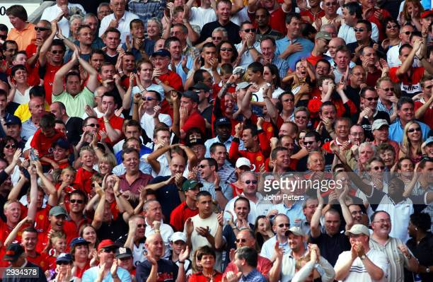 Manchester United Fans celebrate after Ole Gunnar Solskjaer scores during the match between Manchester United v West Bromwich Albion at Old Trafford...