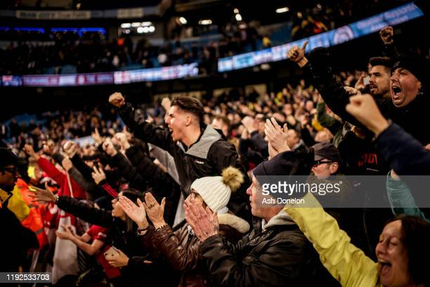 Manchester United fans celebrate after the Premier League match between Manchester City and Manchester United at Etihad Stadium on December 07 2019...