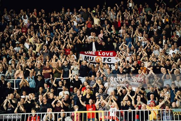 Manchester United fans celebrate after the UEFA Europa League group L match between Partizan and Manchester United at Partizan Stadium on October 24...
