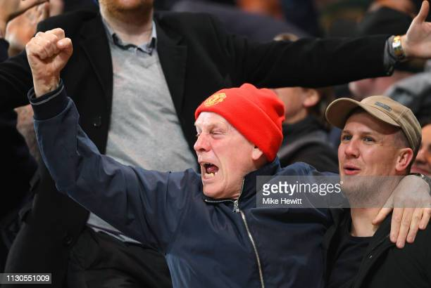 Manchester United fans celebrate as Ander Herrera scores his team's first goal during the FA Cup Fifth Round match between Chelsea and Manchester...