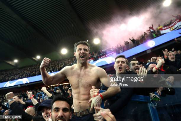 Manchester United fans celebrate during the UEFA Champions League Round of 16 Second Leg match between Paris SaintGermain and Manchester United at...