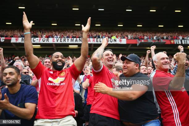 Manchester United fans celebrate victory after the Premier League match between Manchester United and West Ham United at Old Trafford on August 13...