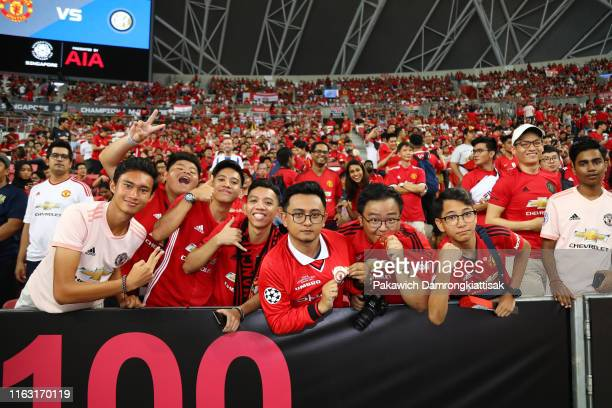 Manchester United fans cheer prior to the 2019 International Champions Cup match between Manchester United and FC Internazionale at the Singapore...
