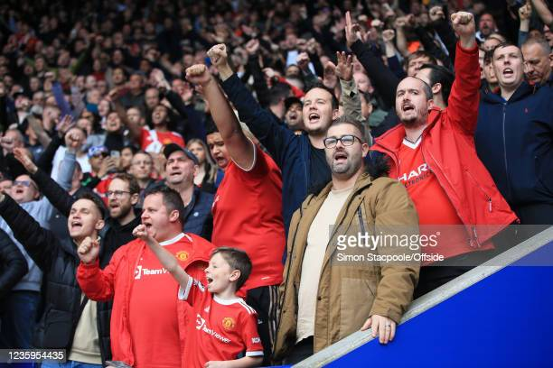 Manchester United fans cheer their side on during the Premier League match between Leicester City and Manchester United at The King Power Stadium on...