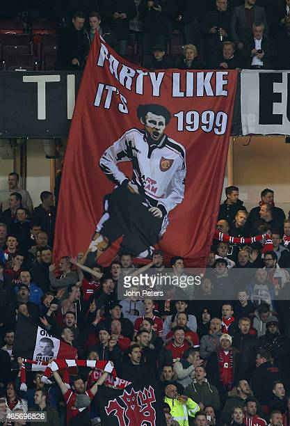 Manchester United fans display a banner celebrating Ryan Giggs' FA Cup semifinal goal of 1999 during the FA Cup Quarter Final match between...