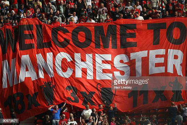 Manchester United fans display a banner during the Barclays Premier League match between Manchester United and Manchester City at Old Trafford on...