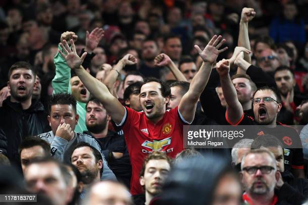 Manchester United fans enjoy the pre match atmosphere ahead of the Premier League match between Manchester United and Arsenal FC at Old Trafford on...