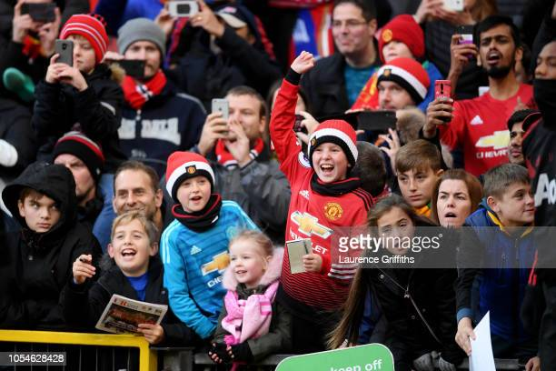 Manchester United fans enjoy the pre match atmosphere prior to the Premier League match between Manchester United and Everton FC at Old Trafford on...
