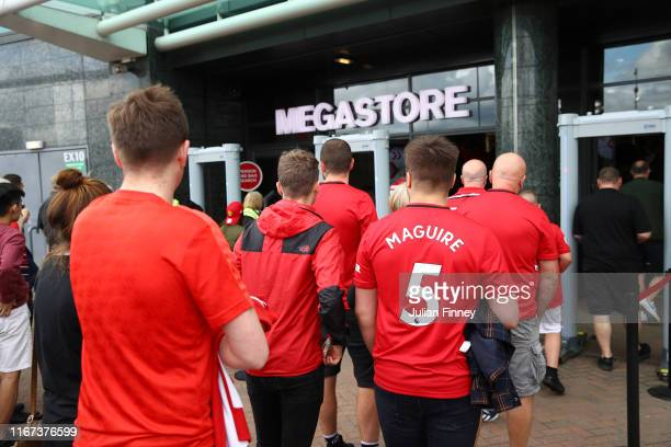 Manchester United fans enter the megastore prior to the Premier League match between Manchester United and Chelsea FC at Old Trafford on August 11...