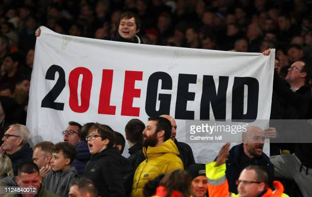 Manchester United fans hold a banner showing support for Ole Gunnar Solskjaer Interim Manager of Manchester United during the FA Cup Fourth Round...
