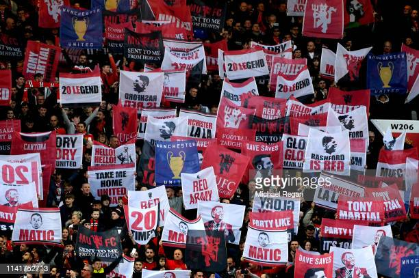 Manchester United fans hold banners and flags prior to the UEFA Champions League Quarter Final first leg match between Manchester United and FC...