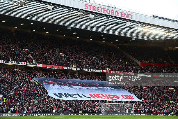 Manchester United fans hold up a banner in memory of the Munich air disaster during the Barclays Premier League match between Manchester United and...