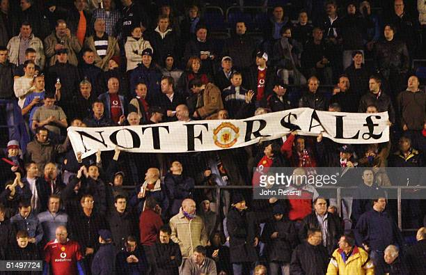 Manchester United fans hold up a banner reading Not For Sale in protest to a possible takeover of the club by American Malcolm Glazer during the UEFA...