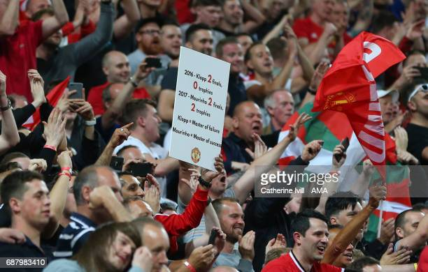 Manchester United fans hold up a sign taunting their Liverpool rivals during the UEFA Europa League Final match between Ajax and Manchester United at...