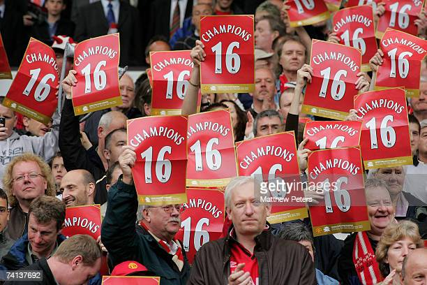 Manchester United fans hold up posters celebrating the club's 16th League title during the Barclays Premiership match between Manchester United and...