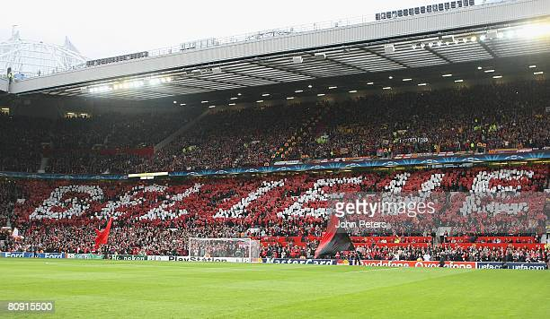 Manchester United fans holds up a sign reading Believe ahead of the UEFA Champions League SemiFinal second leg match between Manchester United and...