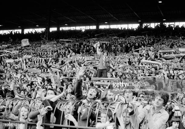 Manchester United fans in the Stretford End supporting their team during the Football League Division One match between Manchester United and...