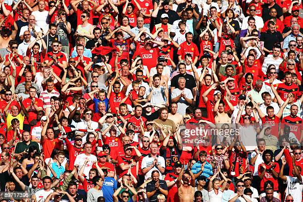Manchester United fans look on during the FA Community Shield match between Manchester United and Chelsea at Wembley Stadium on August 9 2009 in...