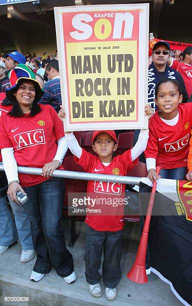 Manchester United fans pose ahead of the Vodacom Challenge preseason friendly match between Kaizer Chiefs and Manchester United at Newlands Stadium...