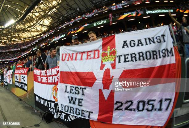 Manchester United fans put up a flag in memory of the victims of the Manchester Concert attack during the UEFA Europa League Final between Ajax and...
