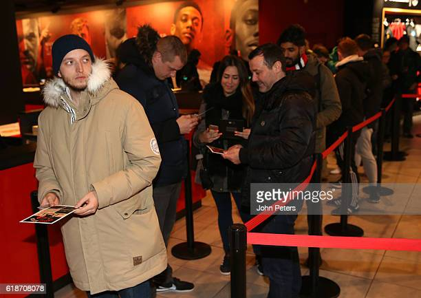 Manchester United fans queue inside the club Megastore ahead of the launch of the new adidas Ashington shoe named in honour of Sir Bobby Charlton's...