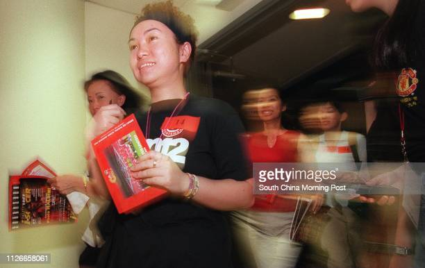 Manchester United fans race for autographs during the teams visit to the HK Stadium